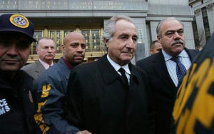 Ponzi Scheme Investor Madoff Appears In Federal Court...NEW YORK - JANUARY 5: Bernard Madoff (C) walks out from Federal Court after a bail hearing in Manhattan January 5, 2009 in New York City. Madoff is accused of running a $50 billion Ponzi scheme through his investment company. Madoff is free on bail and hasnt formally responded to the charges or entered a plea. (Photo by Hiroko Masuike/Getty Images)